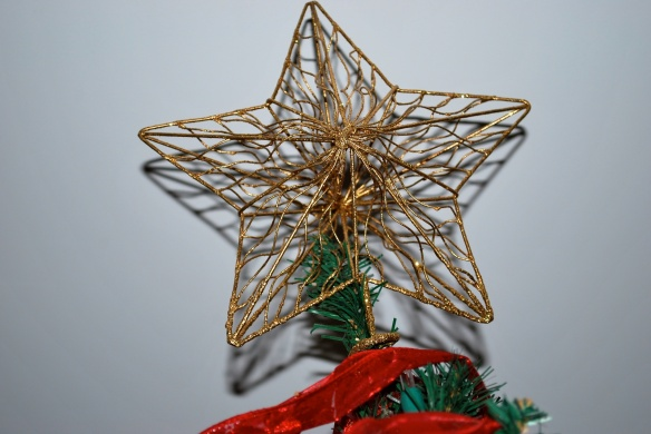 This gold star tops our Christmas tree