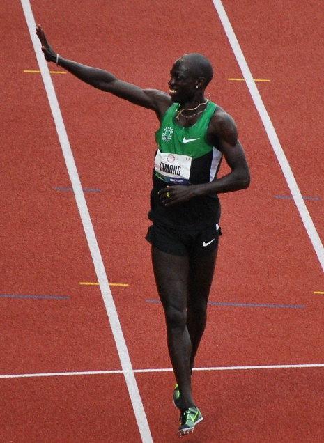 Lomong runs a victory lap after winning a spot on the US Olympic team this past June in Eugene, Ore.