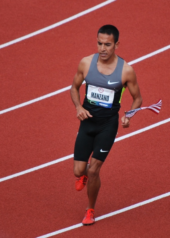 Leo Manzano carries the flag after making the 1500m U.S. team to the 2012 Olympics