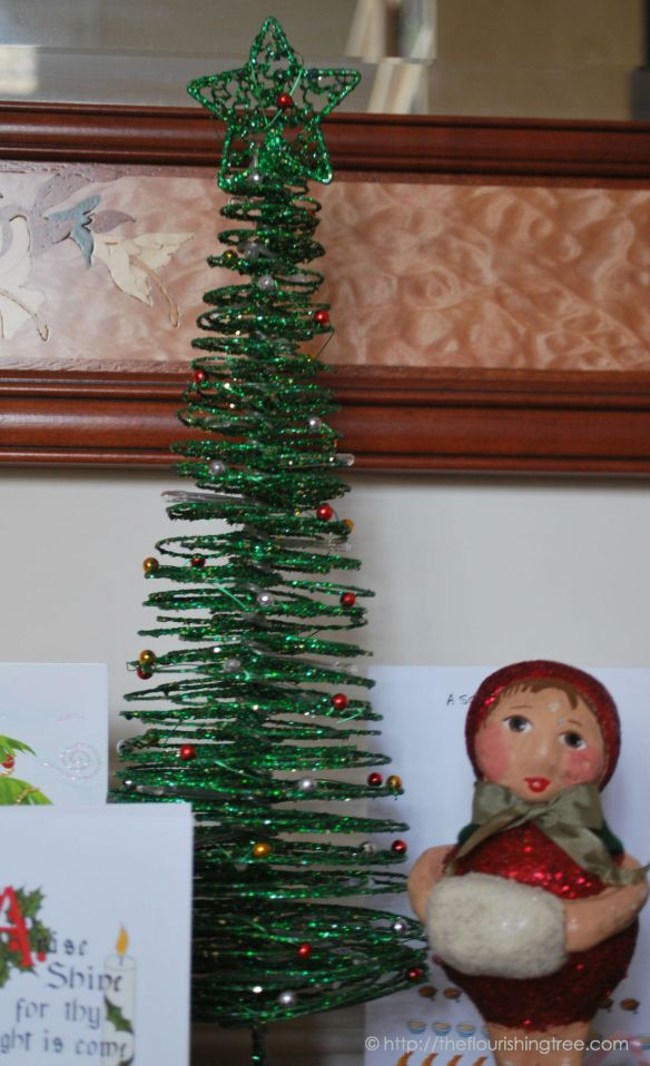 This little green tree decorates the table where we put all our Christmas cards.